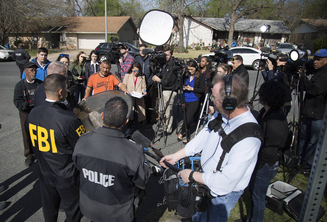 Authorities speak to the media after multiple explosions in Austin on Monday, March 12, 2018. Police are responding to another explosion Monday, that badly injured a woman, hours after a package b ...