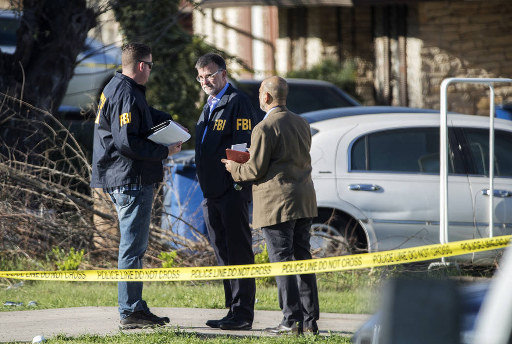 Authorities investigate the scene after multiple explosions in Austin on Monday, March 12, 2018. Police are responding to another explosion Monday, that badly injured a woman, hours after a packag ...