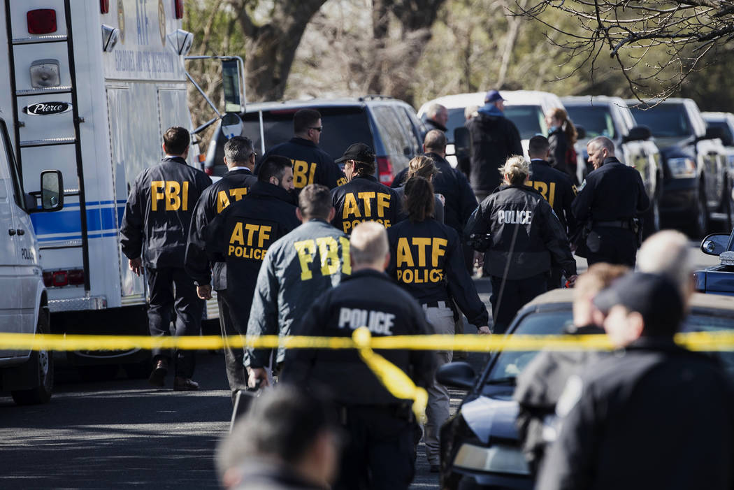 Authorities work on the scene of an explosion in Austin on Monday, March 12, 2018. Two package bomb blasts a few miles apart killed a teenager and wounded two women in Austin on Monday, less than  ...
