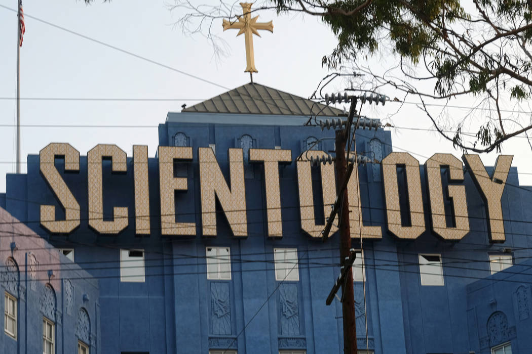 The Scientology Cross perched atop the Church of Scientology in Los Angeles on Aug. 25, 2016. (AP Photo/Richard Vogel)