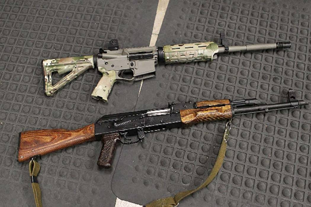 An AR-15 sporting rifle, top, and an AK-47-style rifle lie side by side in January at Battlefield Vegas. The two rifles are often confused by media, law enforcement and the public.