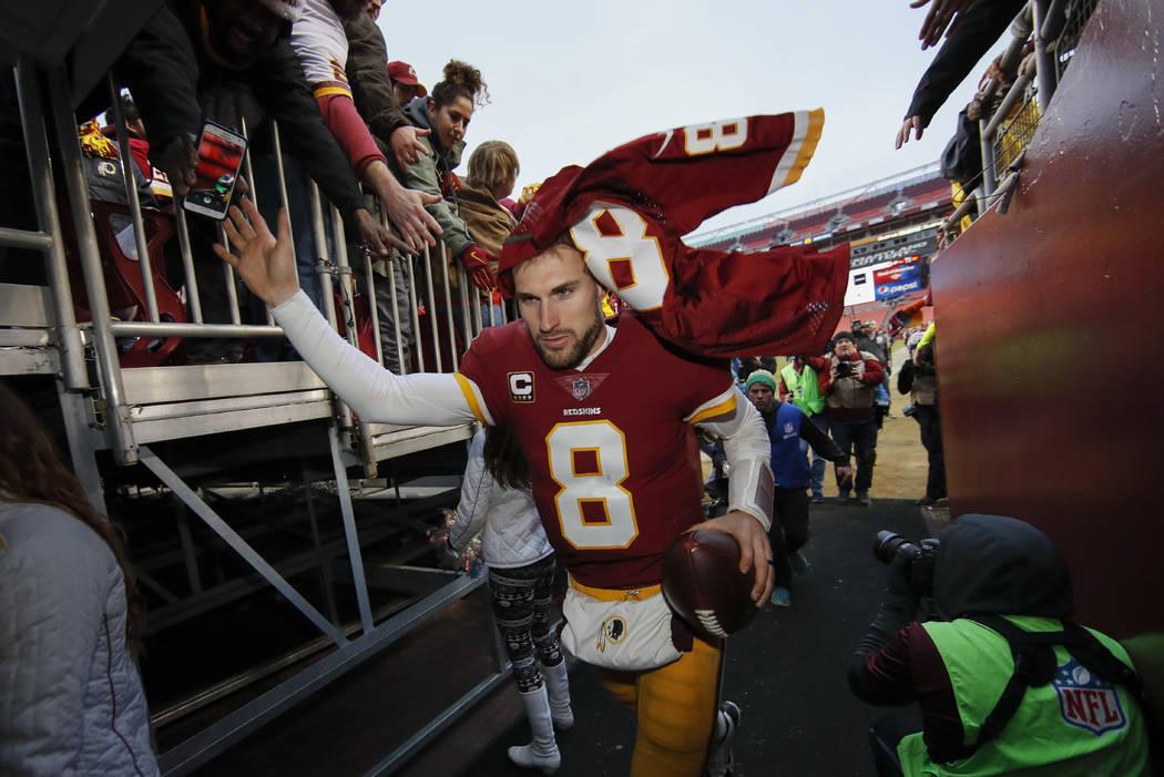 Washington Redskins quarterback Kirk Cousins (8) leaves the field after an NFL football game against the Denver Broncos in Landover, Md., Sunday, Dec 24, 2017. The Redskins defeated the Broncos 27 ...