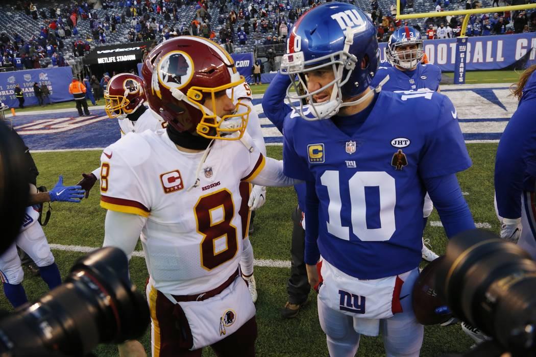 Washington Redskins quarterback Kirk Cousins (8) greets New York Giants quarterback Eli Manning (10) after an NFL football game Sunday, Dec. 31, 2017, in East Rutherford, N.J. (AP Photo/Mark Lennihan)