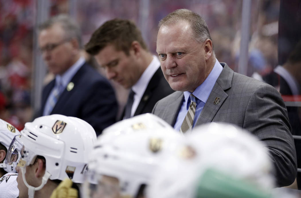 Vegas Golden Knights head coach Gerard Gallant stands in the bench in the third period of an NHL hockey game against the Washington Capitals, Sunday, Feb. 4, 2018, in Washington. The Knights won 4 ...