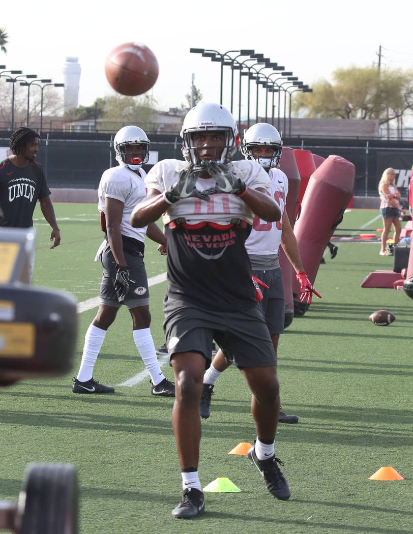 UNLV wide receiver Darren Woods Jr. (10) prepares to catch the ball during team practice on Tuesday, March 13, 2018, in Las Vegas. Bizuayehu Tesfaye/Las Vegas Review-Journal @bizutesfaye