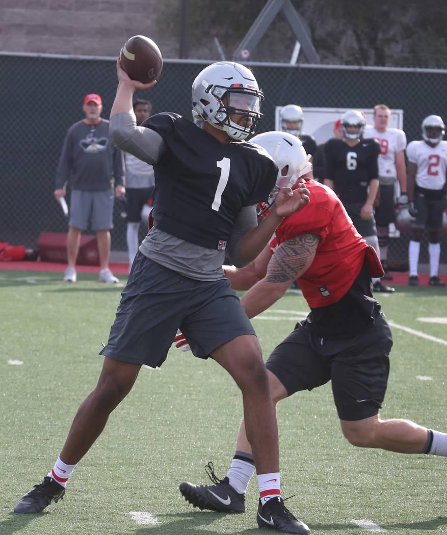 UNLV quarterback Armani Rogers prepares to throw the ball during team practice on Tuesday, March 13, 2018, in Las Vegas. Bizuayehu Tesfaye/Las Vegas Review-Journal @bizutesfaye