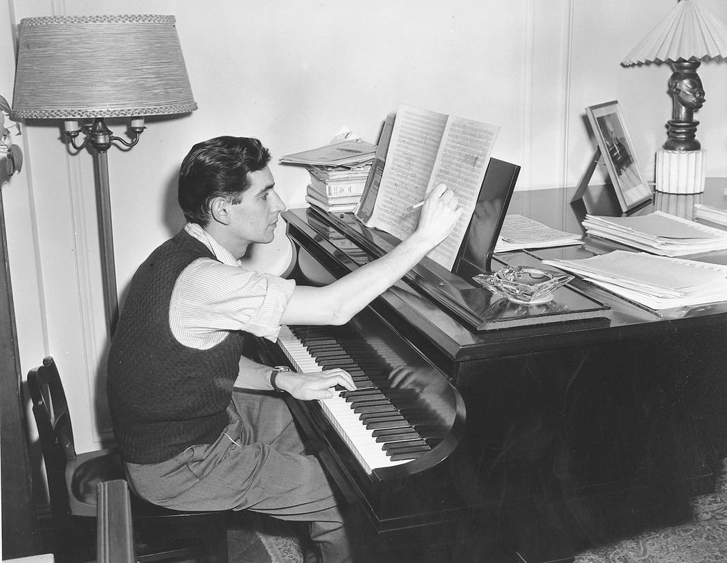 FILE - In this Feb. 24, 1945 file photo American-born conductor, composer, and pianist Leonard Bernstein works on a new musical score in his West side apartment in New York City. Bernstein would h ...