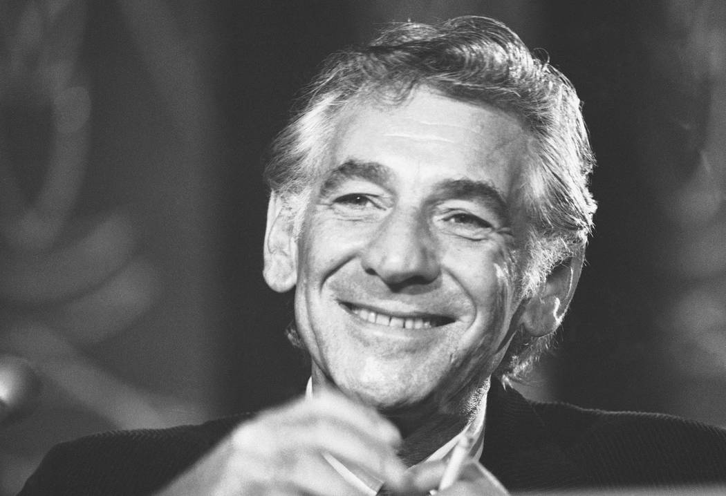 FILE - In this July 26, 1971 file photo conductor Leonard Bernstein tells reporters in Washington that the work he is preparing for the 1971 opening of the John F. Kennedy Center for the Performin ...