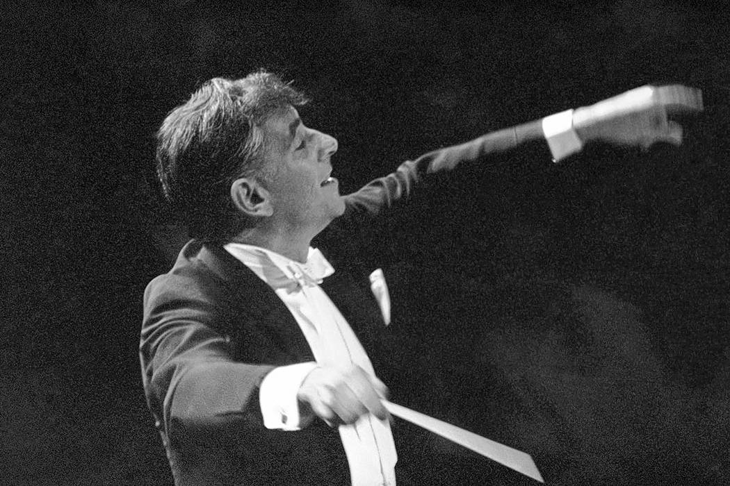 Leonard Bernstein leads the New York Philharmonic Orchestra in the inaugural concert in New York's new Philharmonic Hall on Sept. 24, 1962. Bernstein would have turned 100 next year — a remembra ...
