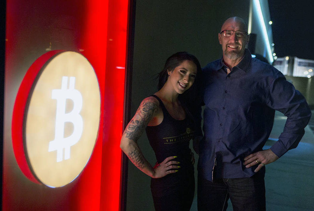 Owner Nick Blomgren and bartender Deianna Lo next to the club's Bitcoin sign outside of the Legends Room in Las Vegas on Wednesday, March 21, 2018. Patrick Connolly Las Vegas Review-Journal @PConnPie