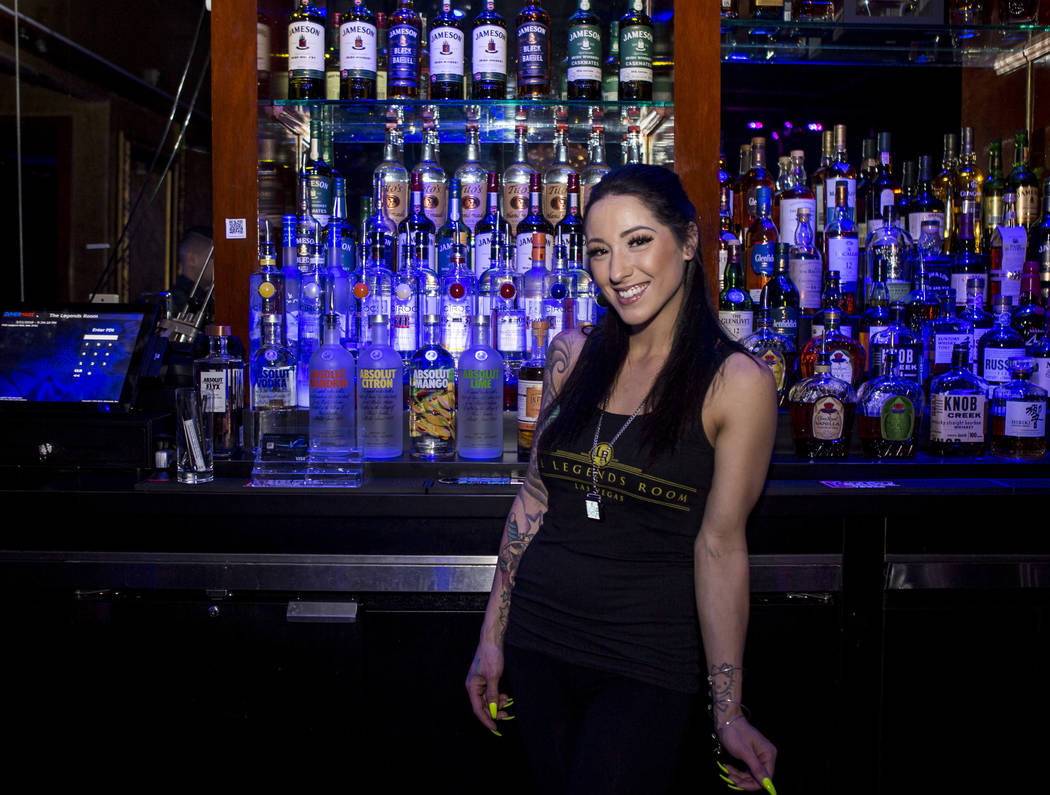 Bartender Deianna Lo shows off a QR code necklace that can be used to pay for drinks and services at the Legends Room in Las Vegas on Wednesday, March 21, 2018. Patrick Connolly Las Vegas Review-J ...