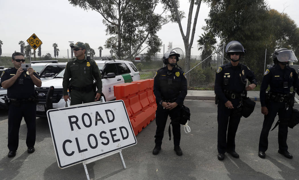 Police standby as President Donald Trump reviews border wall prototypes, Tuesday, March 13, 2018, in San Diego. (AP Photo/Evan Vucci)