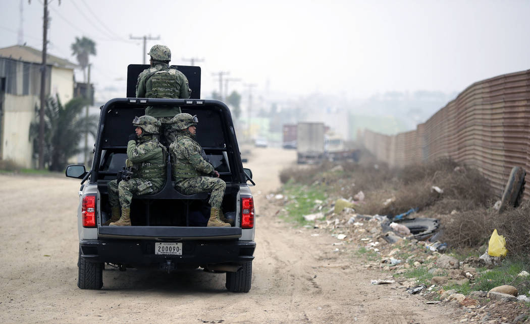Mexican Navy officers patrol on the Mexico side of the border on Tuesday, March 13, 2018, in Tijuana, Mexico. President Trump is scheduled to visit the site of the border wall prototypes which are ...