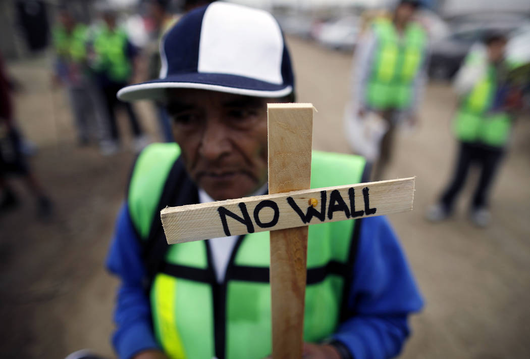 Roberto Perez Garcia of Mexico participates in a rally against the border wall on Tuesday, March 13, 2018, in Tijuana, Mexico. President Trump is scheduled to visit the site of the border wall pro ...