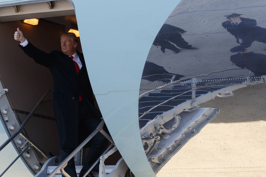 President Donald Trump boards Air Force One for a trip to California to view border wall prototypes, Tuesday, March 13, 2018, in Andrews Air Force Base, Md. (AP Photo/Evan Vucci)