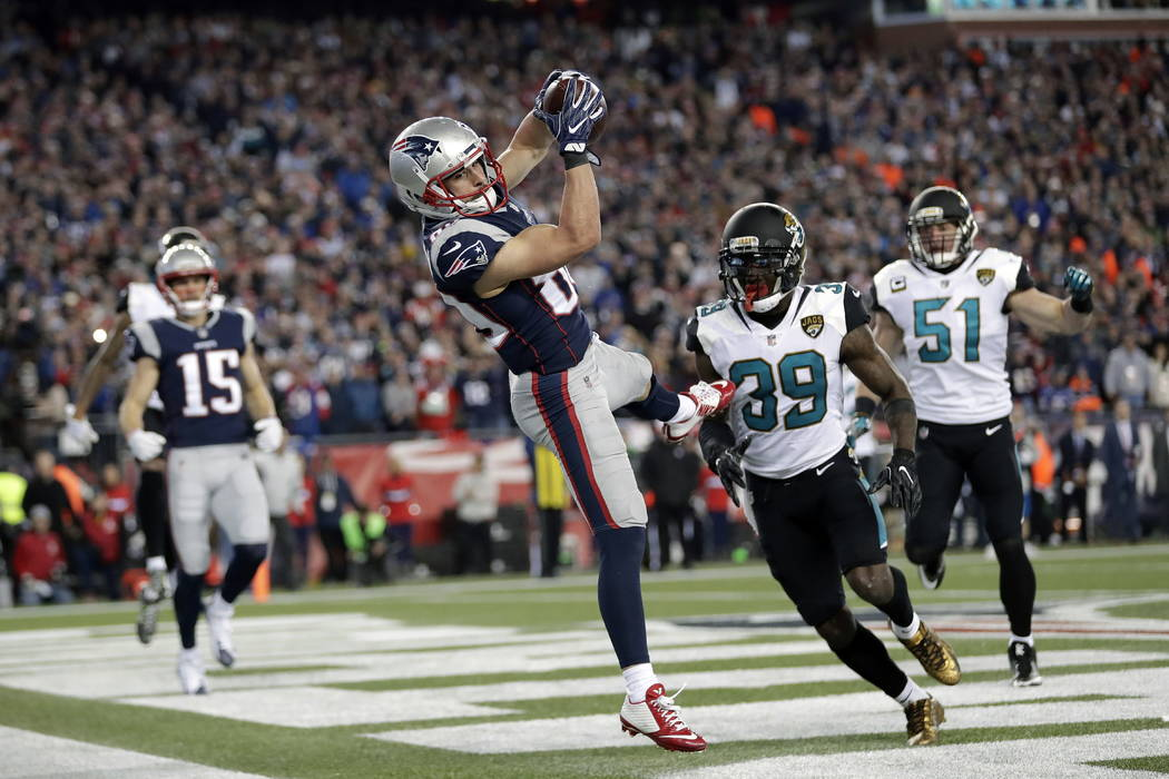 New England Patriots wide receiver Danny Amendola (80) catches a touchdown pass in front of Jacksonville Jaguars safety Tashaun Gipson (39) and linebacker Paul Posluszny (51) during the second hal ...