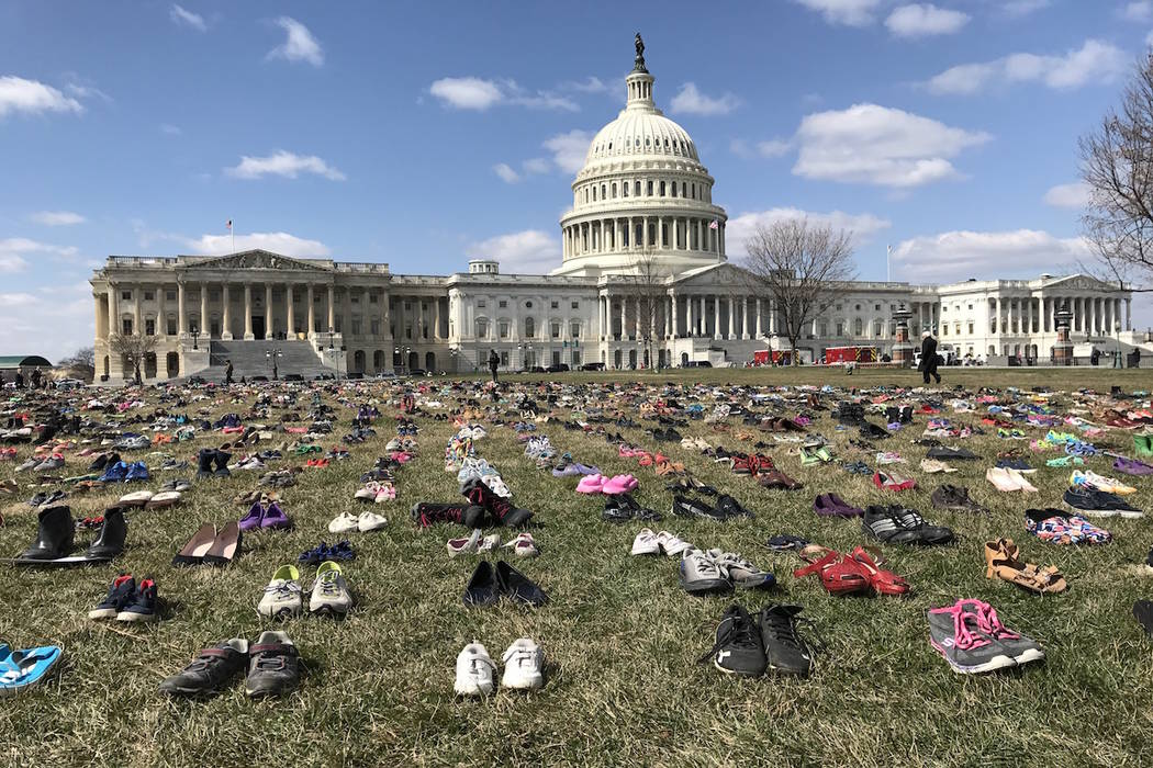 Pairs of shoes are laid out on the lawn outside of the U.S. Capitol on Wednesday, March 13, 2018. (Gary Martin/Las Vegas Review-Journal)
