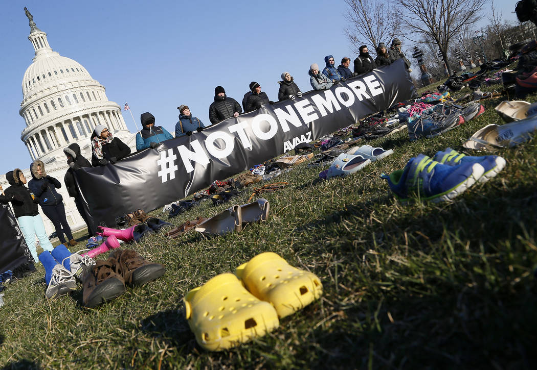 IMAGE DISTRIBUTED FOR AVAAZ - 7,000 empty pairs of shoes for every child killed by guns in the US since Sandy Hook cover the southeast lawn of U.S. Capitol Building on Tuesday, March 13, 2018 in W ...