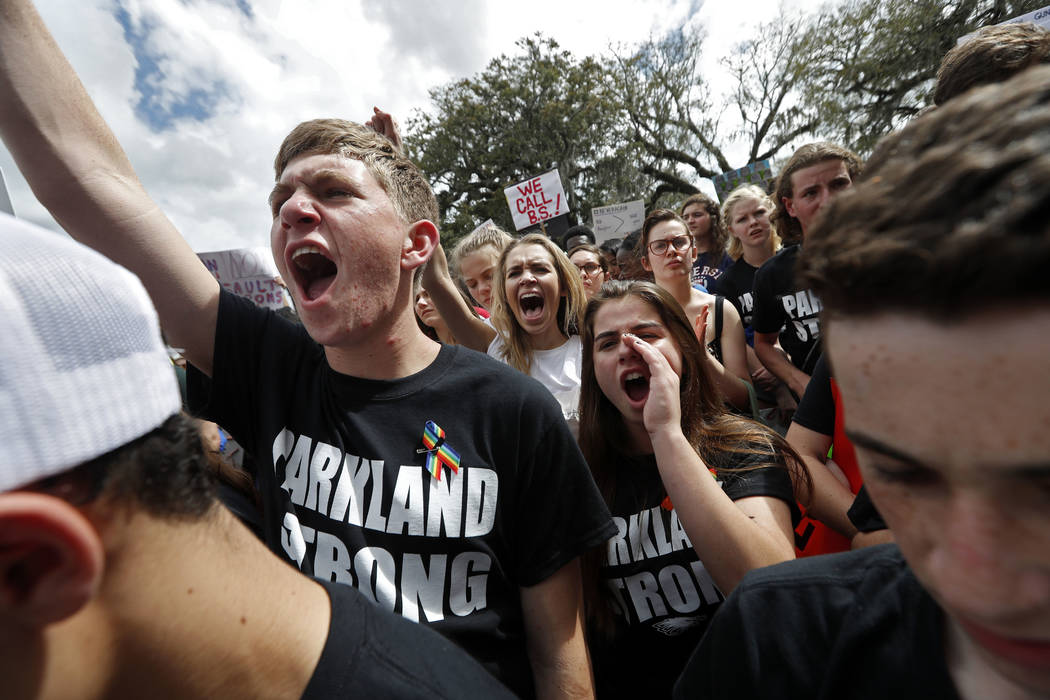 Student survivors from Marjory Stoneman Douglas High School participate in a rally for gun control reform on the steps of the state capitol, in Tallahassee, Fla., Wednesday, Feb. 21, 2018. (AP Pho ...