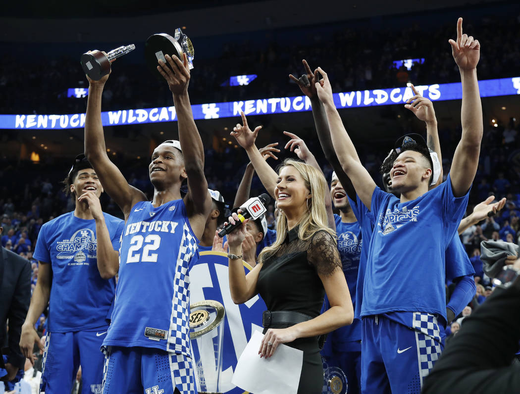 Kentucky players celebrate after beating Tennessee 77-72 in an NCAA college basketball championship game at the Southeastern Conference tournament Sunday, March 11, 2018, in St. Louis. (AP Photo/J ...