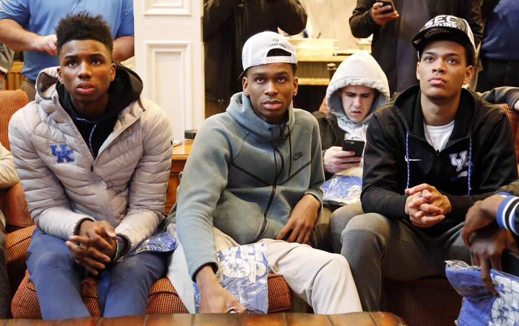 Members of the Kentucky basketball team, from left, Hamidou Diallo, Shai Gilgeous-Alexander, Brad Calipari and Quade Green watch the NCAA Tournament selection show at the home of head coach John C ...