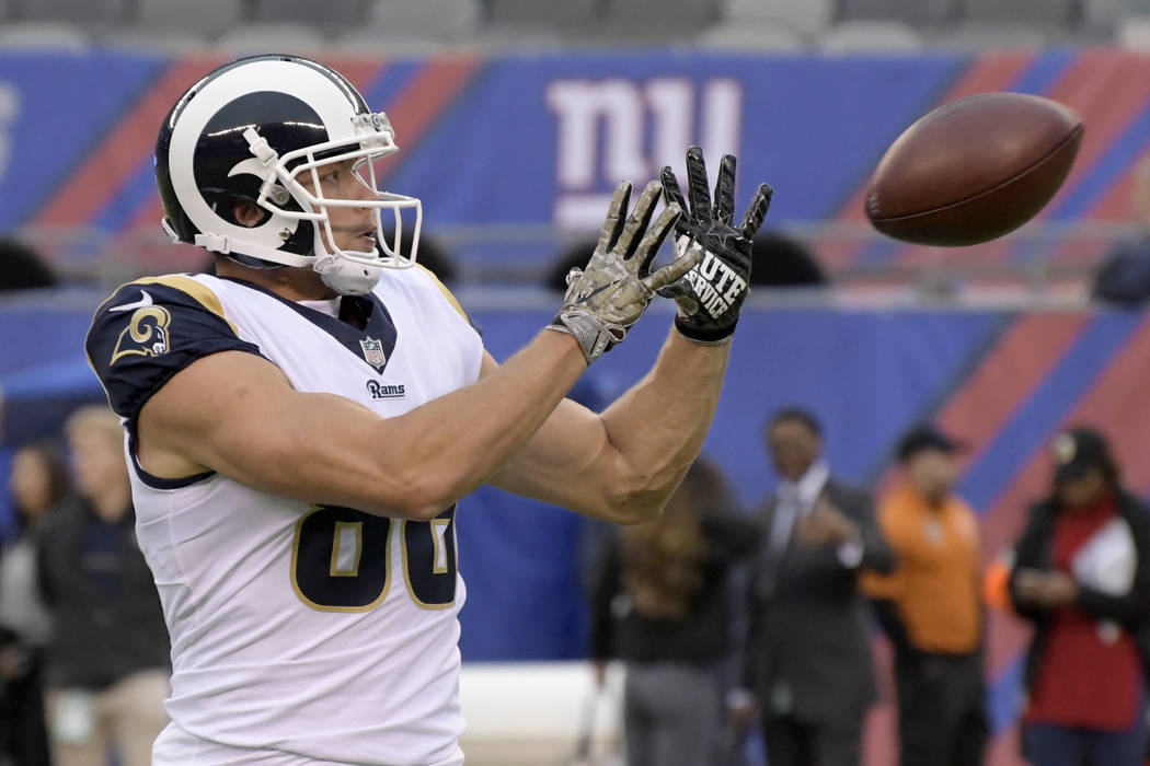 Los Angeles Rams tight end Derek Carrier warms up before an NFL football game against the New York Giants Sunday, Nov. 5, 2017, in East Rutherford, N.J. (AP Photo/Bill Kostroun)