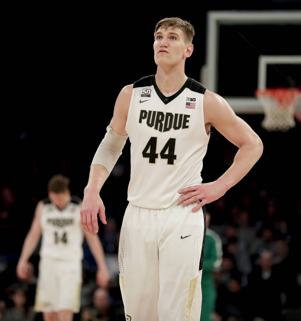 Purdue center Isaac Haas (44) reacts as he walks down the court after a Purdue turnover to Michigan during the second half of the NCAA Big Ten Conference tournament championship college basketball ...