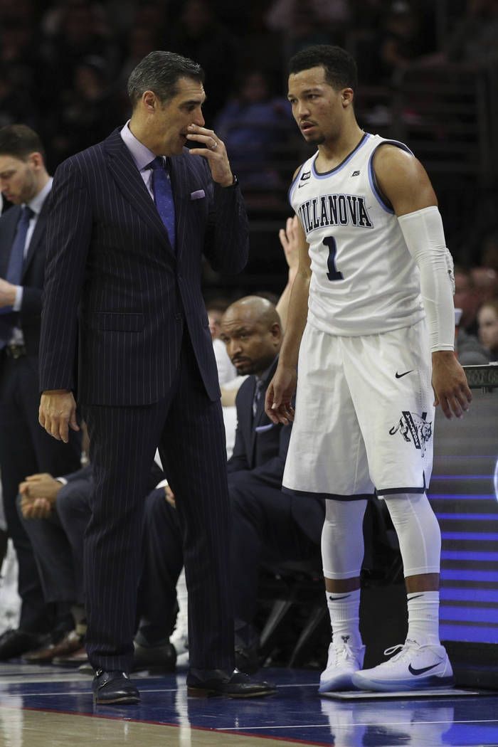 Villanova's head coach Jay Wright talks things over with Jalen Brunson during the second half of an NCAA basketball game against Georgetown, Saturday, March 3, 2018, in Philadelphia. Villanova won ...