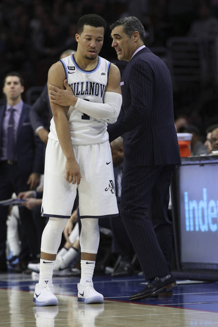 Villanova's Jalen Brunson, left, reacts to comment by head coach Jay Wright, right, during the second half of an NCAA basketball game against Georgetown, Saturday, March 3, 2018, in Philadelphia.  ...