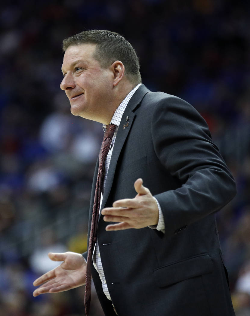 Texas Tech head coach Chris Beard talks to a player during the first half of an NCAA college basketball game against West Virginia in the semifinals of the Big 12 conference tournament in Kansas C ...
