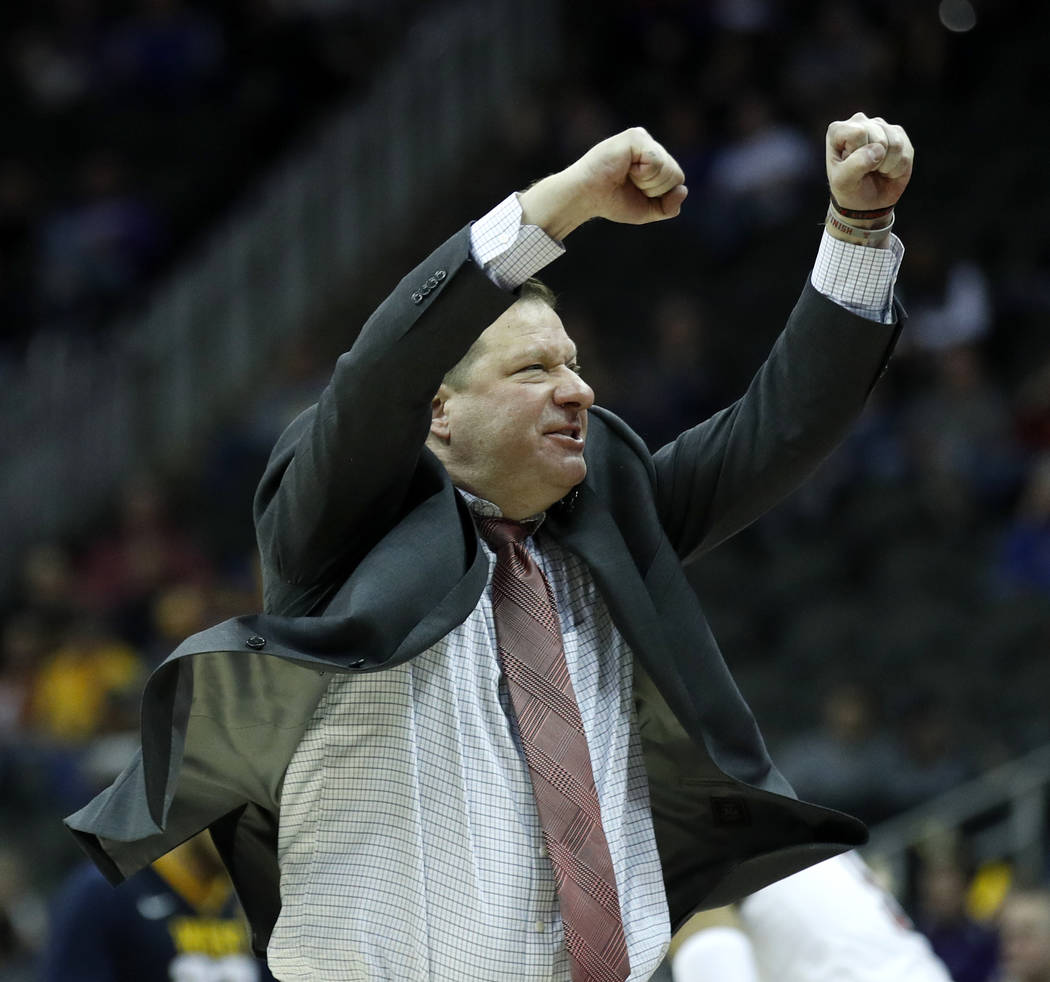 Texas Tech coach Chris Beard cheers on his team during the second half of an NCAA college basketball game against West Virginia n the Big 12 men's tournament Friday, March 9, 2018, in Kansas City, ...