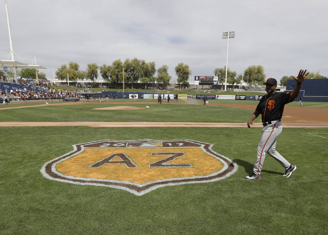 San Francisco Giants' Barry Bonds waves to fans before a spring training baseball game between the Milwaukee Brewers and the San Francisco Giants, Wednesday, March 22, 2017, in Phoenix. (AP Photo/ ...