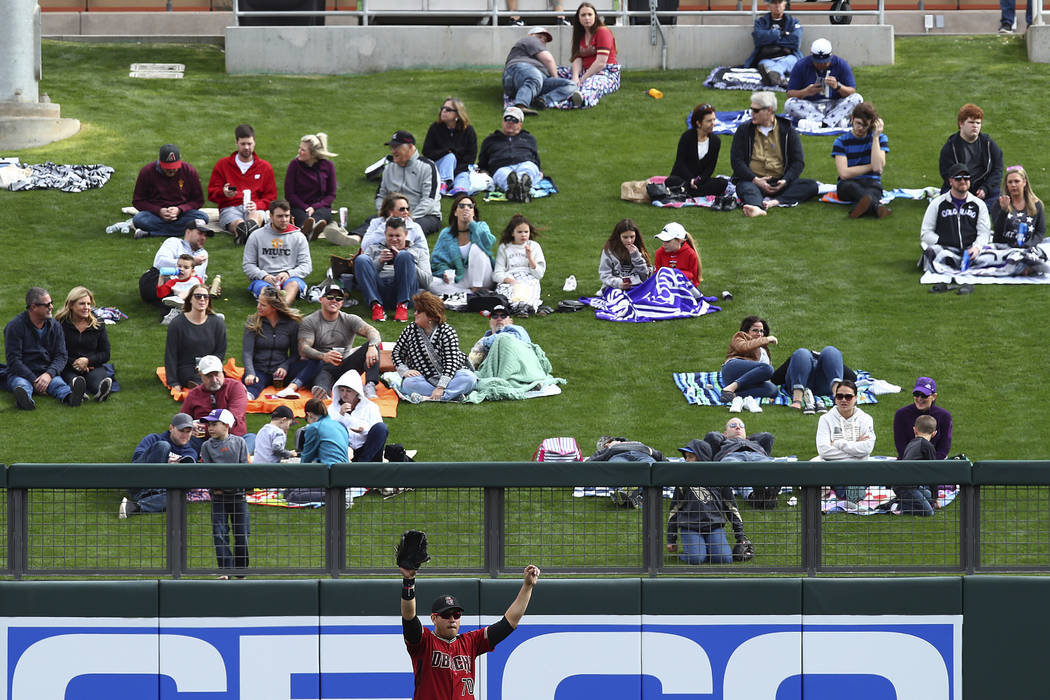 Fans sit in the bleacher area of Salt River Fields at Talking Stick to view the Arizona Diamondbacks play the Colorado Rockies in a spring training exhibition baseball game on Friday, Feb. 23, 201 ...