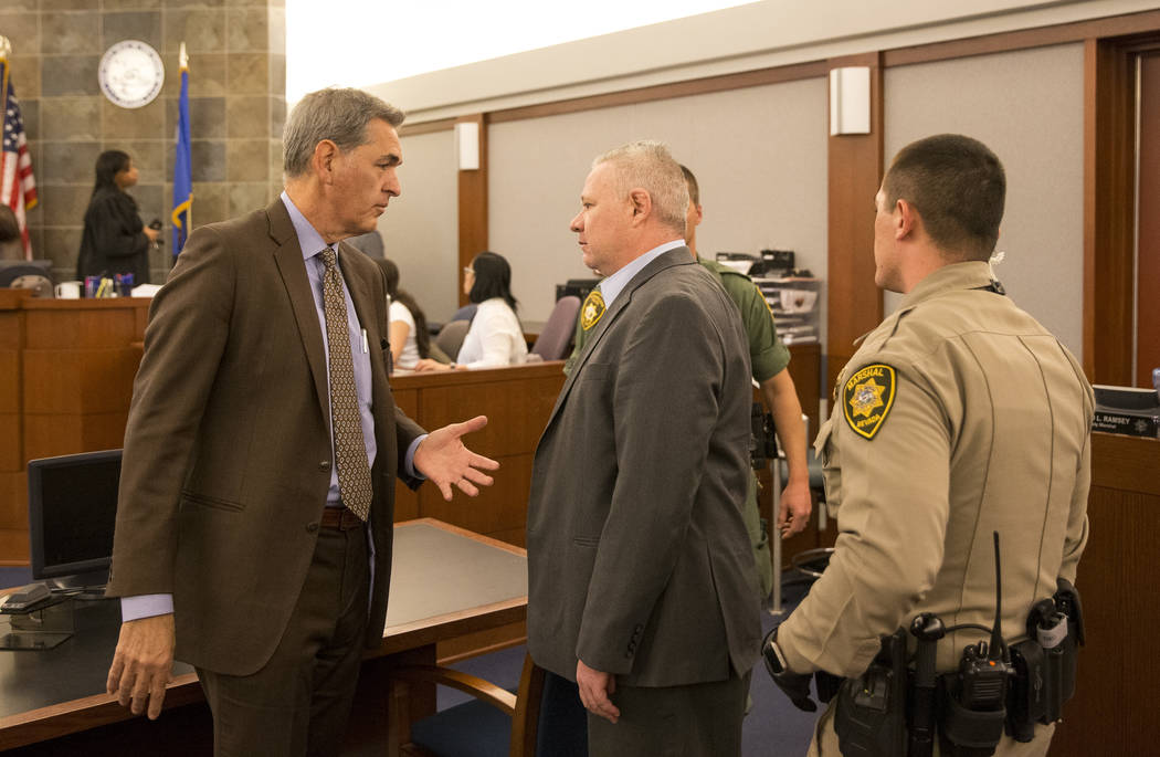 Jarom Boyes, center, speaks to attorney Gabriel Grasso, left, after he was found guilty of involuntary manslaughter at the Regional Justice Center in downtown Las Vegas on Friday, March 9, 2018. R ...