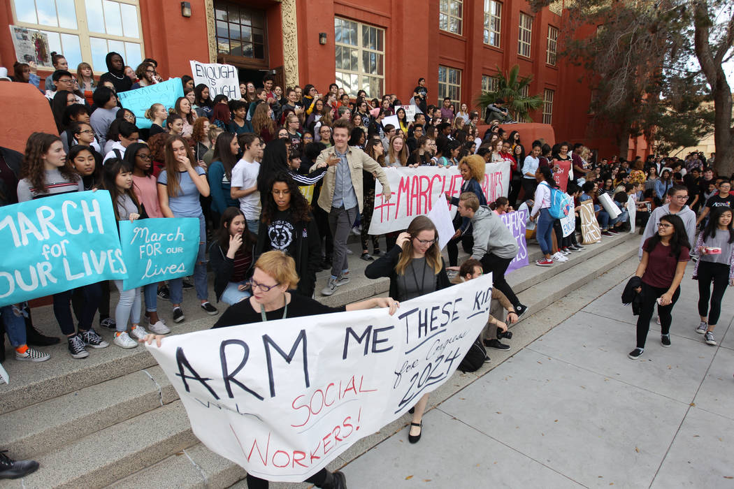 Students at Las Vegas Academy gather on the steps at the entrance to the school after walking out of class Wednesday, March 14, 2018, to mark the one-month anniversary of a shooting at a Florida s ...