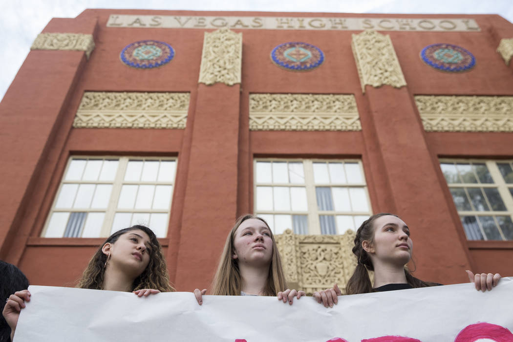 Students from left, Yasmine Abdelshahid, 15, Katelyn Murphy, 15, and Audrey Freund, 15, participate in the national walkout to protest gun violence, at Las Vegas Academy in Las Vegas, Wednesday, M ...