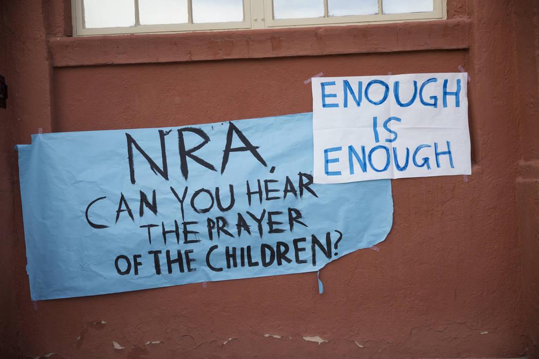 Signs outside of Las Vegas Academy following a student walkout to protest gun violence, in Las Vegas, Wednesday, March 14, 2018. Erik Verduzco Las Vegas Review-Journal @Erik_Verduzco