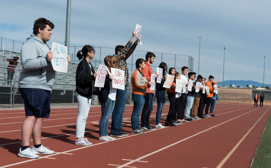 Students at Clark High School in Las Vegas hold up names of each of the 17 victims in the Parkland shooting during the national student walkout, March 14, 2018. (Marcus Villagran)