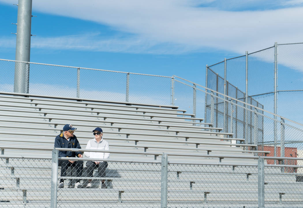 Crossing guards Cliff Leonard and Kay Leonard show their support for students at Clark High School in Las Vegas participating in the national student walkout, March 14, 2018. (Marcus Villagran)