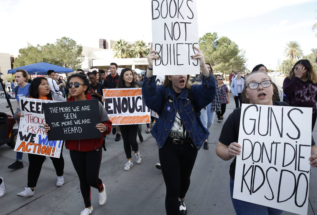 UNLV students, including Emily Bolshazy, right, shout slogans as they march at their campus in Las Vegas on Wednesday, March 14, 2018 as part of a nationwide protest against gun violence. Bizuayeh ...