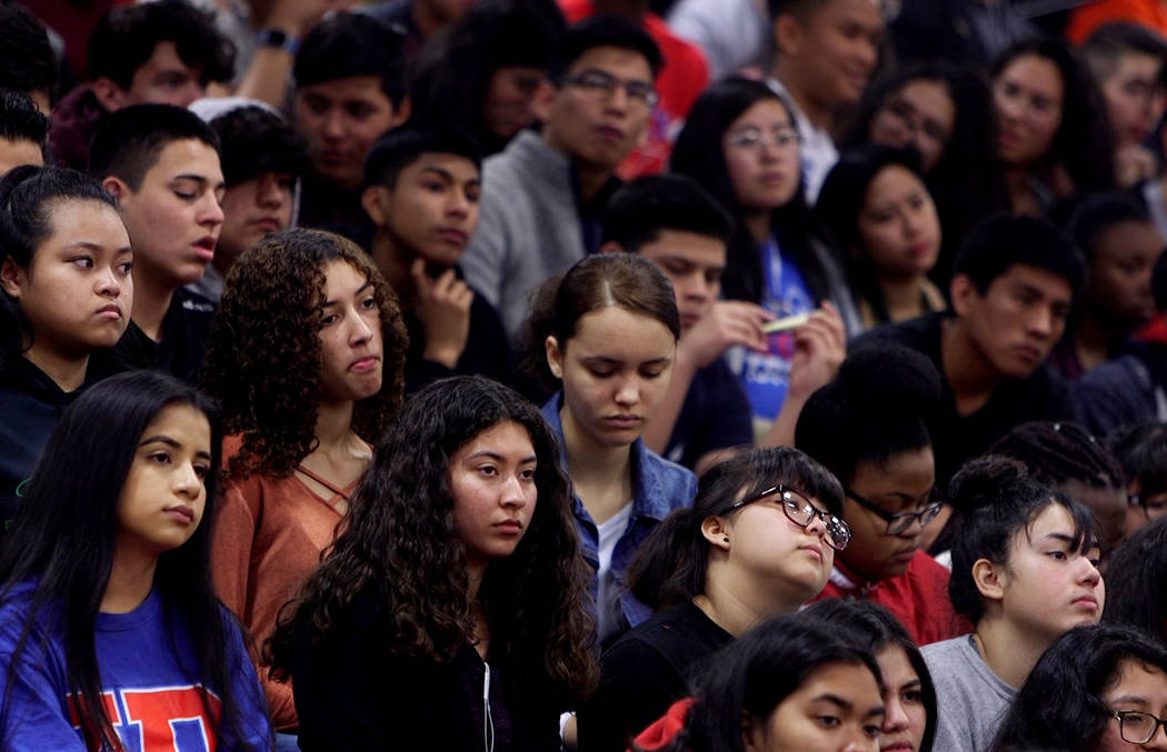 Students listen during an assembly at Valley High School in Las Vegas, Wednesday, March 14, 2018. Students organized an assembly to talk about gun control in response to the Parkland shooting. Rac ...