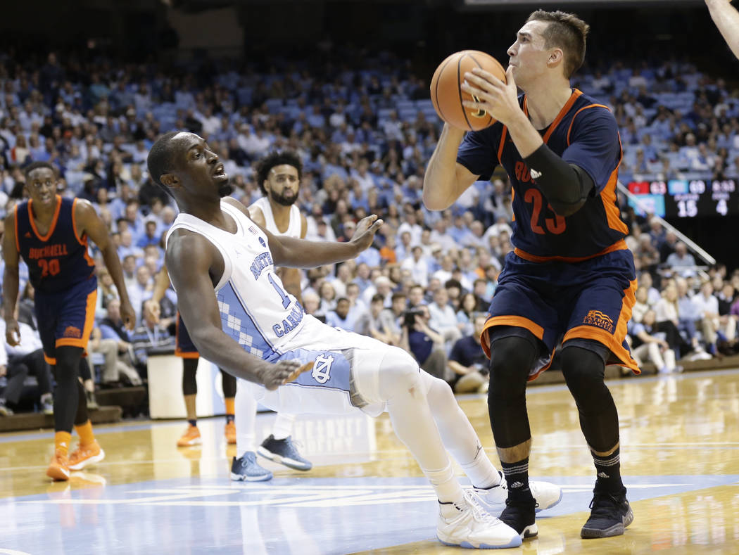 North Carolina's Theo Pinson (1) defends against Bucknell's Zach Thomas (23) during the second half of an NCAA college basketball game in Chapel Hill, N.C., Wednesday, Nov. 15, 2017. North Carolin ...