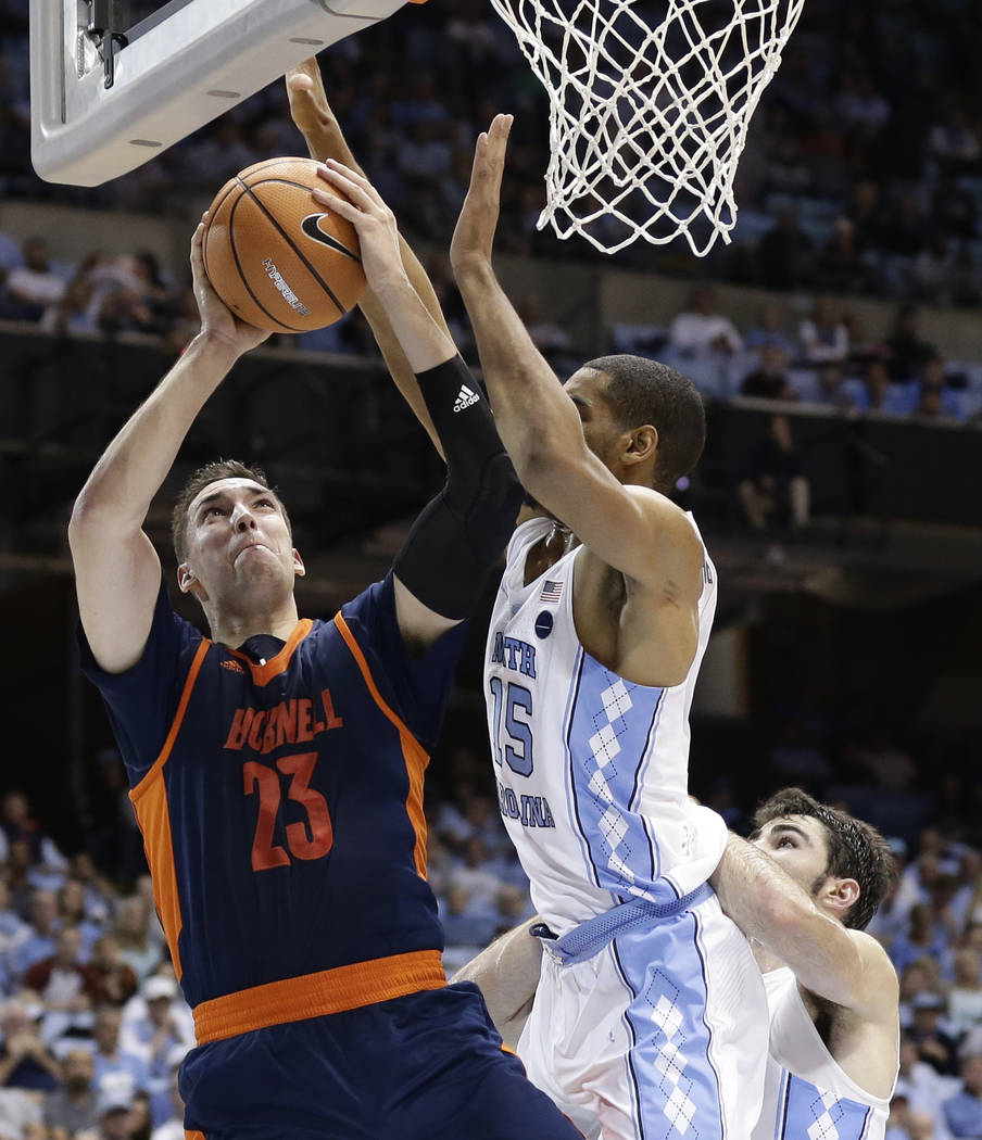 North Carolina's Garrison Brooks (15) guards Bucknell's Zach Thomas (23) during the second half of an NCAA college basketball game in Chapel Hill, N.C., Wednesday, Nov. 15, 2017. North Carolina wo ...