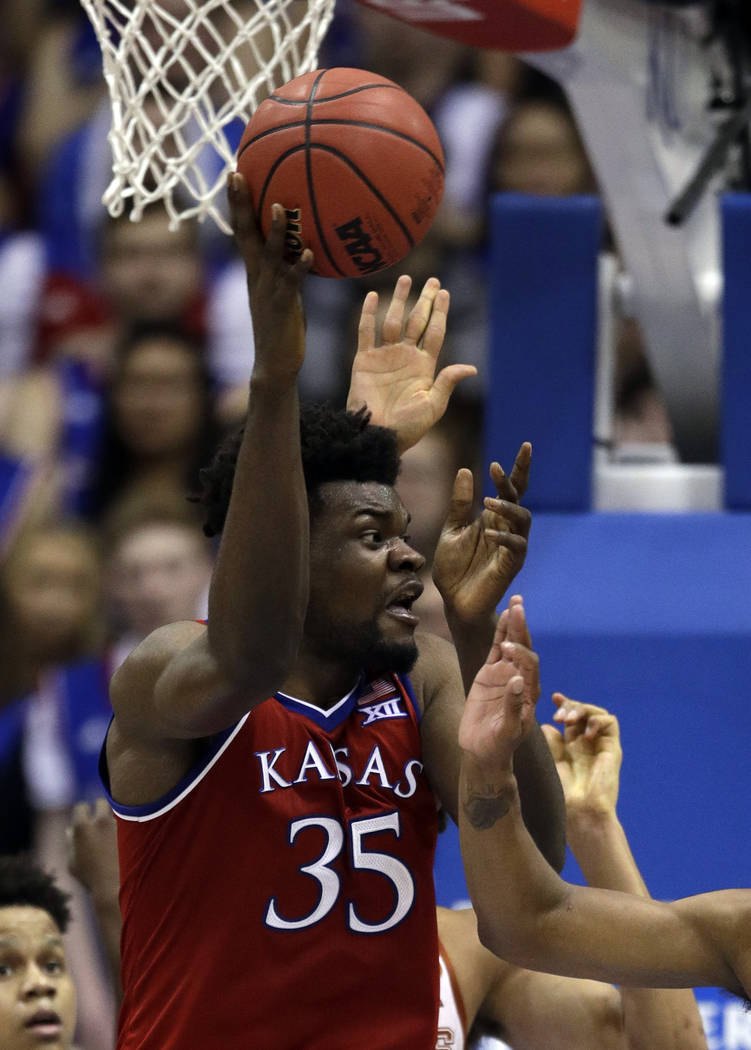 Kansas center Udoka Azubuike (35) during the first half of an NCAA college basketball game against Texas in Lawrence, Kan., Monday, Feb. 26, 2018. Kansas defeated Texas 80-70. (AP Photo/Orlin Wagner)