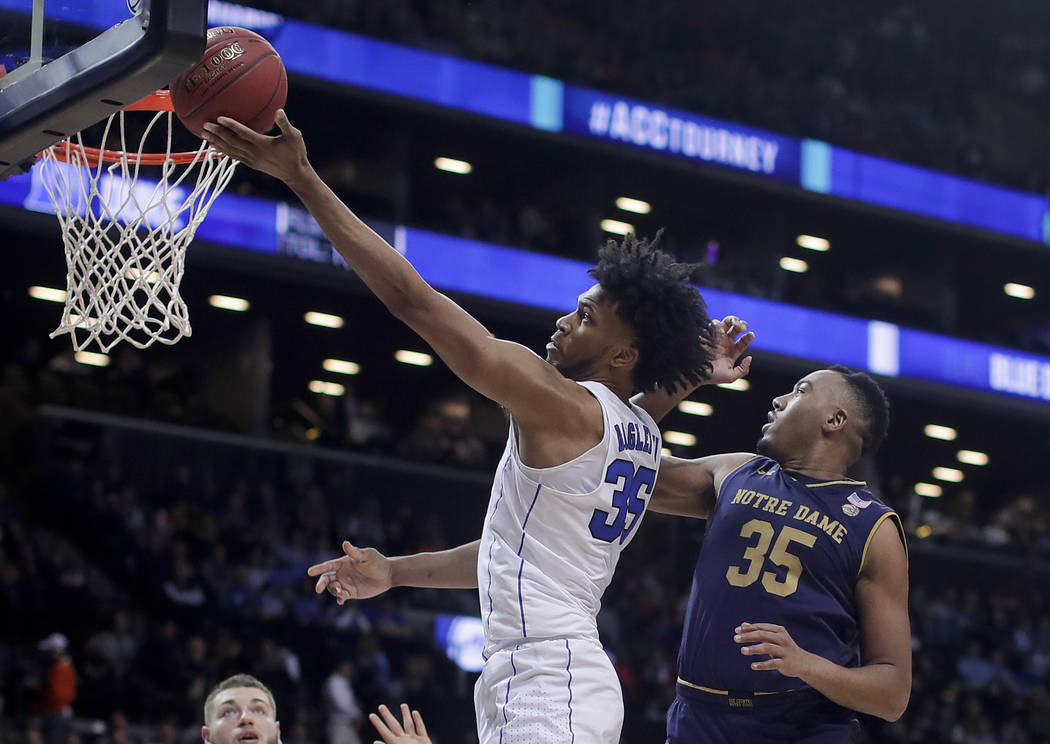 Duke forward Marvin Bagley III (35) shoots against Notre Dame forward Bonzie Colson (35) during the second half of an NCAA college basketball game in the Atlantic Coast Conference men's tournament ...