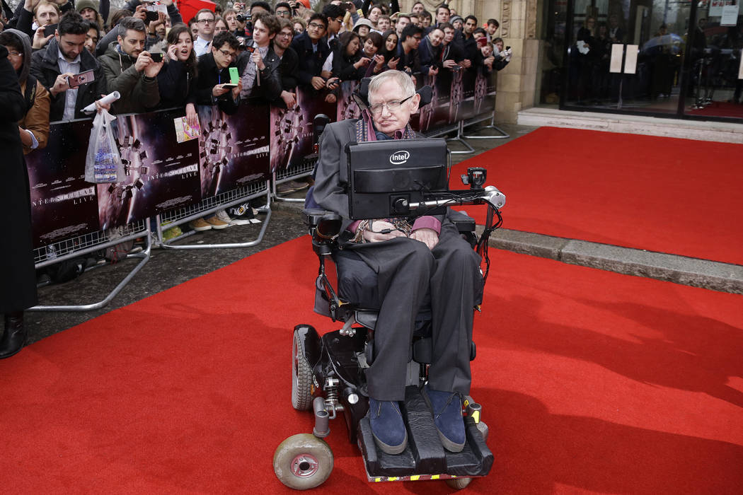 In this March 30, 2015 file photo, Professor Stephen Hawking poses for photographers upon arrival for the Interstellar Live show at the Royal Albert Hall in central London. Hawking, whose brillian ...