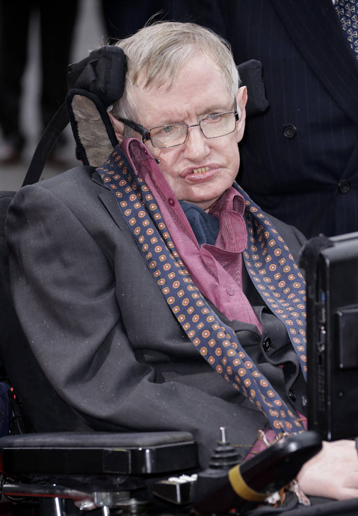 FILE - In this March 30, 2015 file photo, Professor Stephen Hawking arrives for the Interstellar Live show at the Royal Albert Hall in central London. Hawking, whose brilliant mind ranged across t ...
