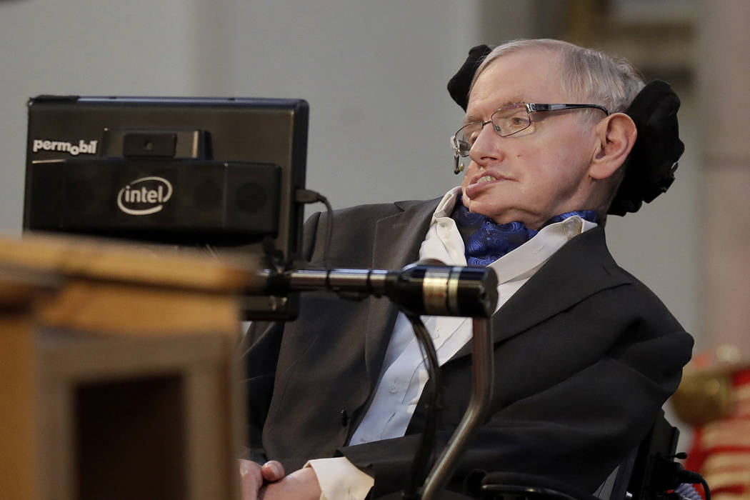 In this Monday, March 6, 2017 file photo, Britain's Professor Stephen Hawking receives the Honorary Freedom of the City of London during a ceremony at the Guildhall in the City of London.  (AP Pho ...
