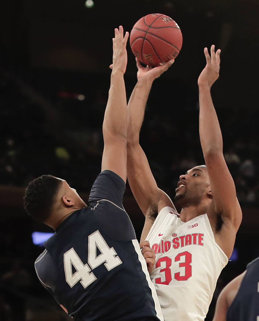 Ohio State forward Keita Bates-Diop (33) puts up a shot against Penn State forward Julian Moore (44) during the first half of an NCAA Big Ten Conference tournament college basketball game, Friday, ...