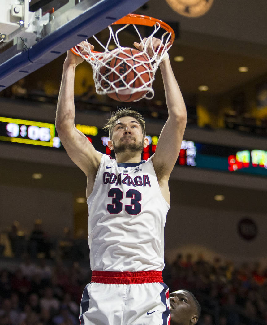 Gonzaga's Killian Tillie (33) dunks against Loyola Marymount during the second half of an NCAA college basketball game in the quarterfinals of the West Coast Conference tournament, Saturday, March ...